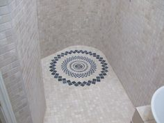 Great use of a stone mat created by Core and Ore in a wet area , botticino marble