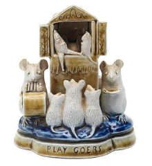 George Tinworth for Doulton Lambeth, 'Playgoers' A good mouse group, circa 1880 Modelled as three mice watching a Punch and Judy show, with a musician mouse and a mouse with a plate standing either side of the show, in tones of green, blue and cream 13cm high, incised GT with impressed factory marks (minor chips to ears). Sold at Bonhams Sep 2008 for £4560