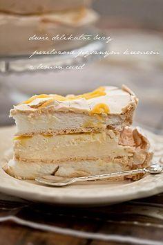 Pavlova Cake: lemon curd and mascarpone cheese - decor with raspberry.