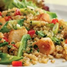 Toasted Quinoa Salad with Scallops & Snow Peas | This scallop-studded quinoa salad gets an exciting texture from crunchy snow peas, red bell pepper and scallions. Feel free to substitute shrimp or thin slices of chicken for the scallops.