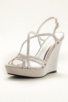 256df0b7e3b Spice up your look with these dazzling high heel wedges! Caparros strappy  high heel wedge sandals with crystal embellisment. Heel height  Fully lined.