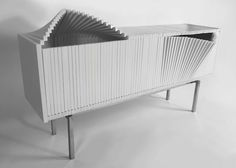 """For the Design Miami 2014, the furniture """"Wave"""" has been thought by New York-based designer Sebastian Errazuriz. This white wooden cabinet opens like a paper fan and can take original and sculptural shapes contrary to traditional furniture's doors"""
