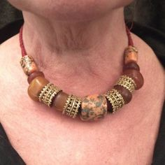 """A beautiful necklace from the Newar area (Katmandu, Nepal) with hight standart quality coral, real old amber and gilded elements on a adjustable red rope...today on my site www.halter-ethnic.com under my item  """"My Lucky Finds"""""""