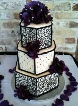 purple and black wedding cake..I'd want pink instead of purple.