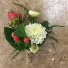 white button mum boutonniere with peach hypericum berries and accent greens, wrapped with white satin and twine