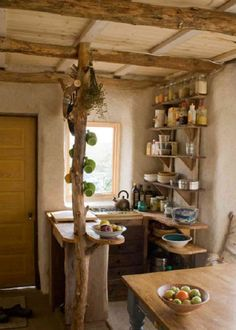 A tiny house should emphasize important features.  Like this one, I'd put the kitchen towards the front.