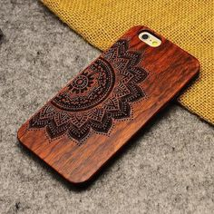 Made with plastic and 100% real wood, the Wooden Mandala iPhone Case gives yoursmartphone elegant style.