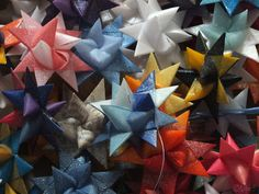Moravian Origami Stars - folded from four strips of paper -the finished stars are dipped in paraffin wax & glittered with ultrafine diamond dust glitter, thus rendering a luxuriously shimmering surface without any actual glitter flakes to be seen.   Traditionally Moravian stars were used outdoors. Hence the wax, which makes them resistant to rain and snow.
