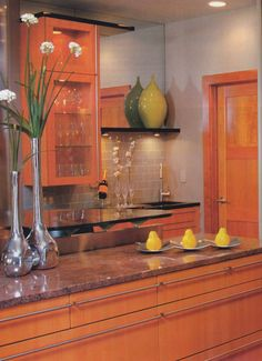 Inspired by pears, flashes of yellow and green add interest to this warm kitchen.