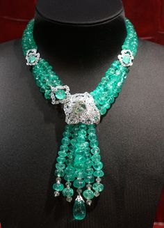 Necklace, diamonds and emerald beads