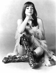 Sonja of Curved Air  http://www.curvedair.com/Graphics/SonjaFeathers.JPG