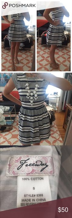 """Navy and white striped cotton dress Excellent condition!  Purchased for ~$100.  Worn about 2x, ties in the back.  Light weight and perfect for a spring or summer occasion. Pair with wedges or nude heels to add a bit of sass!  Model is 5'4"""", 123 lbs. Freeway Dresses"""