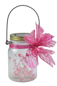 This jar would work great for a bridal shower with it's pink and white beads, and a pink zebra striped bow.