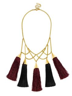 Plum and black tassels feel extra dramatic with gold detailing.