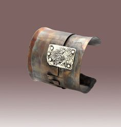 Cuff | Warren and Robbin Moeller-Smith. Bronze with patina and sterling silver.
