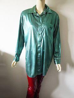 He encontrado este interesante anuncio de Etsy en https://www.etsy.com/es/listing/510221475/esmeralda-vintage-anos-80-camisa