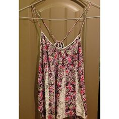 Lace floral blouse/crop top Great condition, no stains or tears. Adjustable back, can be made into a blouse or tightened to a crop top. Great for summer! American Eagle Outfitters Tops Blouses