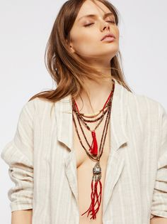 Sun Ceremony Layered Necklace   Layered necklace with a beaded design and a western-inspired feel.  * Leather fringe * Stone accents * Horn pendant * Adjustable lobster clasp closures