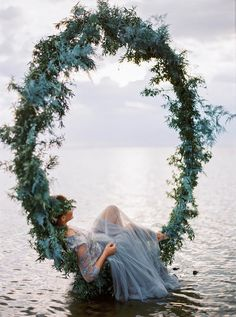 Beach Bride in a Winter Greenery Wreath