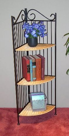 """4D Concepts Metal and Wicker Shelf by 4D Concepts. $47.99. Metal and wicker. 12-1/5Lx12-1/5Wx43-1/5H"""". Decorative black metal back folds open, then wicker shelves fold into place on the uprights. 3-Tier corner shelf; 3 wicker shelves. Metal and wicker 3 - tier Corner Unit and Bookcase by 4D Concepts. Simply elegant. PRICED RIGHT! Add warmth and style to any room. For storage, display or both... each unit is durable, easy to clean and ready to complement a wide range o..."""