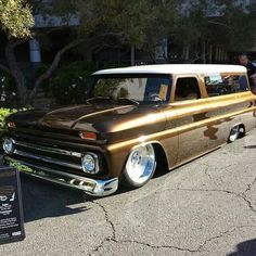 1964 - 66 body style chevy chevrolet suburban with modifed rear side glass, slammed, solid wheels