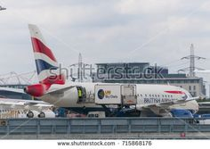 LONDON, UNITED KINGDOM - AUGUST 02, 2013 A British Airways airplane loading catering before take off in London City Airport