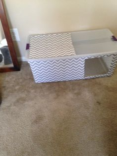 Litter box enclosure. Plastic tote, contact paper. Serrated steak knife used to cut hole.