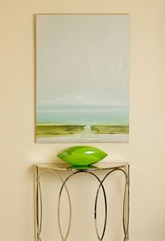 Unframed simple painting of a beach scene over a contemporary shiny entry table| House of Turquoise: Bella Interiors