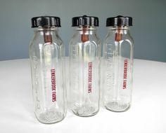 Glass baby bottles.