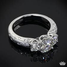 This Custom 3 Stone Champagne Engagement Ring is set in platinum and holds 0.80ctw in A CUT ABOVE® Hearts and Arrows Diamond Melee. The 4 prong center head holds a beautiful 0.865ct A CUT ABOVE® Diamond.