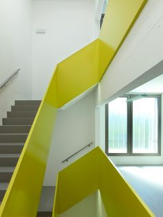 New operations center Rolle / Burckhardt + Partner #neon #stairs #architecture