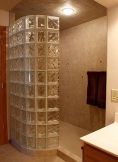 This is a bathroom we did.  I love the curved glass block to the beautiful tiled walk in shower.  Very spa-like!