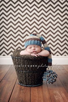 Caralee Case Photography: newborns.  I love the color scheme and hat.  So cute.