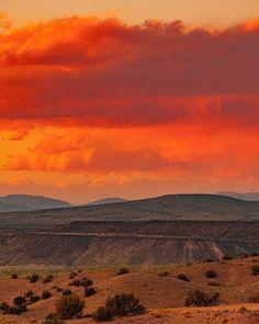 Sunset over the hills of Placitas, Rio Grande river valley, Santa Ana mesas, San Felipe shield volcano, and the Jemez Mountains. (at Placitas, New Mexico)
