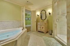 En suite bathroom for pretty green bedroom in Atlanta  mansion.