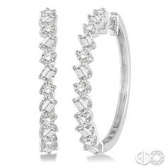 These earrings are a unique take on classic diamond hoops alternating round cut diamonds and emerald cut diamonds! These earrings are a unique take on classic diamond hoops alternating round cut diamonds and emerald cut diamonds! Diamond Hoop Earrings, Diamond Bangle, Silver Hoop Earrings, Diamond Studs, Sterling Silver Jewelry, Diamond Jewelry, Diamond Necklaces, Earring Studs, Silver Rings