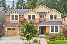 5 bed 3.5 bath 4,000 sq ft of luxury living in this 2015 Snoqualmie Ridge home. Snoqualmie Ridge, Carriage Garage Doors, Open Concept Home, California Closets, Timber House, Al Fresco Dining, Brickwork, Large Bedroom, Wall Treatments