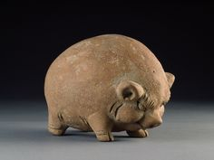 Terracotta piggy bank, made in East Java in the 15th century (via).