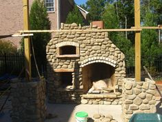 Outdoor fireplace pizza oven combo.