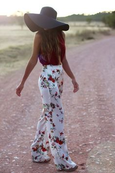 Coachella Fashion. Shop this look on Lookastic:  http://lookastic.com/women/looks/black-straw-hat-burgundy-sleeveless-top-white-floral-wide-leg-pants/9948  — Black Straw Hat  — Burgundy Sleeveless Top  — White Floral Wide Leg Pants