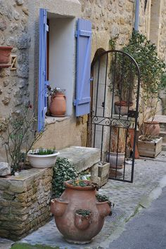 Happiness is a sunny day in the South of France! Walk along the narrow streets of the village of Lauris, and you will find treasures everywhere. Stone walls to keep out the heat of the day, bright blue shutters flung open to catch the breeze, the iron gate that welcomes you in, and a strawberry jar, with pockets, made of local clay, filled growing herbs.