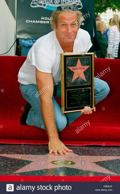 Download this stock image: Grammy award-winning singer Michael Bolton poses with his newly  unveiled star on the Hollywood Walk of Fame in Hollywood, August 27,  2002. Bolton has sold over 52 million albums worldwide. REUTERS/Fred  Prouser    FSP - H0N8JX from Alamy's library of millions of high resolution stock photos, illustrations and vectors.