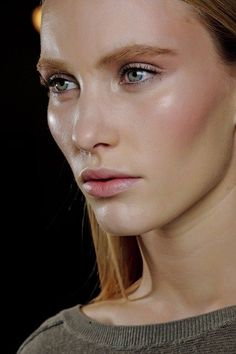 Versace AUTUMN/WINTER 2011-12 - Pat McGrath created flushed cheeks and glowing skin - keeping the brows thick and the lashes curly.