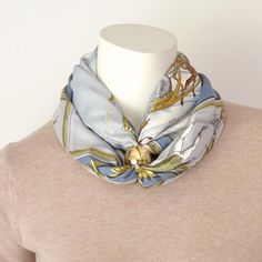 A scarf ring with clean and modern lines and perfect for Hermes 90 and 70 scarves, cashmere shawls/GMs and Maxi Twillys. It is easy to use and lets you create chic and stylish knots and ties. Scarf Knots, Scarf Rings, Head Scarf Tying, Cashmere Shawl, Drawstring Pouch, Chic, Stylish, Hermes, Infinity
