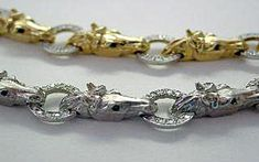 14k White Gold Horsehead Bracelet - Show Stable Artisans 14k White Gold Horsehead Link Bracelet. Features .80ctw Diamonds and Sapphire eyes. A fabulous piece for any horse lover!  Our entire horse head collection has gorgeous bangles, earrings rings, necklaces and pendant enhancers. These amazing  horse heads are very detailed, accurate and beautiful. All horse lovers adore this collection! Also available in yellow gold, HRSC0068.  $12,500.00