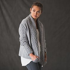 Alluring cables and a draped loop cowl create the unusual but captivating silhouette of the Brewster Cardigan. The generous loop cowl can double as pockets, or the extension can be omitted entirely! Either way, the stunning cables and comfortable fit will make this cardigan a favorite for years to come.