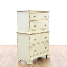 This shabby chic dresser is featured in a solid wood with a distressed off white cream paint finish. This tall dresser has 4 drawers, carved trim and a curved base. Perfect for a small bedroom!  #shabbychic #dressers #talldresser #sandiegovintage #vintagefurniture