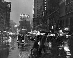 Times Square in the Rain, 1940, photo by Lou Stoumen fromi-am-citizen-insane
