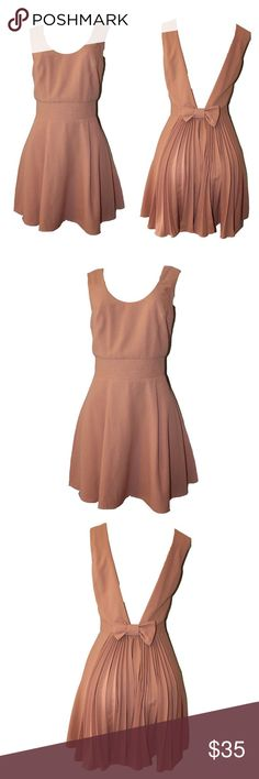 """Rose Dress Boutique item brand new                                                   Nice Rose dress with bow in the back                  length 33"""" length from back 17"""" bust-33"""" waist-26"""" hip 40"""" material does not stretch Dresses"""