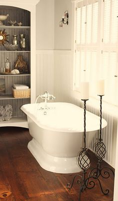 clawfoot tub for farm house also like the sconces and beed board